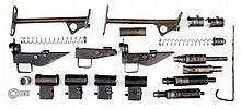 BRITISH MACHINE GUN PARTS KIT LOT W/THREE STEN AND THREE STERLING PARTS KITS PLUS EXTRAS.