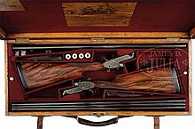 FINE PAIR OF BOSS SIDELOCK EJECTOR GAME SHOTGUNS WITH CASE AND SOME ACCESSORIES.