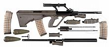 QUALIFIED MANUFACTURING STEYR AUG MACHINE GUN SEAR REGISTERED IN MULTIPLE CALIBERS INSTALLED IN .223 HOST GUN WITH SUPPRESSOR (FULLY TRANSFERABLE).
