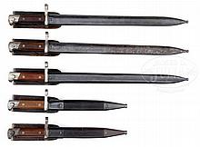 GROUP OF 5 RARE MODEL 1895 WINCHESTER SABER BAYONETS WITH SHEATHS.