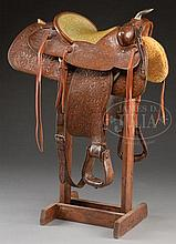 TOOLED WESTERN ROPING SADDLE MADE BY NUDIE'S RODEO TAILORS OF NORTH HOLLYWOOD, CALIFORNIA, ESPECIALLY FOR JOHN WAYNE.