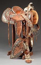 SPECTACULAR SILVER MOUNTED PARADE SADDLE WITH MARTINGALE AND MATCHING SPURS MADE BY KEYSTON BROS, SAN FRANCISCO, CALIFORNIA.