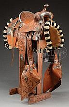 FANCY TOOLED SILVER MOUNTED ROPING SADDLE MADE BY EDWARD H. BOHLIN, INC., HOLLYWOOD, CALIFORNIA.