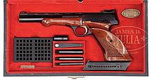EXTREMELY FINE AND DESIRABLE CASED BELGIAN BROWNING MEDALIST .22LR PISTOL WITH ACCESS.