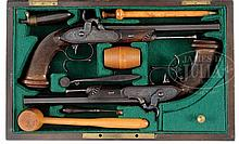 CASED PAIR OF LONFIER A RENNES PERCUSSION TARGET PISTOLS WITH ACCESSORIES.