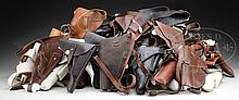 DIVERSE COLLECTOR'S LOT OF 63 MILITARY, POLICE, AND COMMERCIAL HOLSTERS.