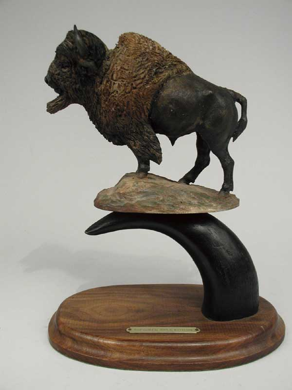 FINE HAND CARVED WOOD SCULPTURE OF BUFFALO BY JOHN H. KITTELSON (1930-).