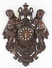 19TH CENT. CONTINENTAL CARVED WALNUT WALL CLOCK