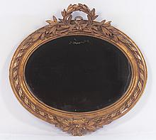 CONTINENTAL GILT DECORATED OVAL MIRROR