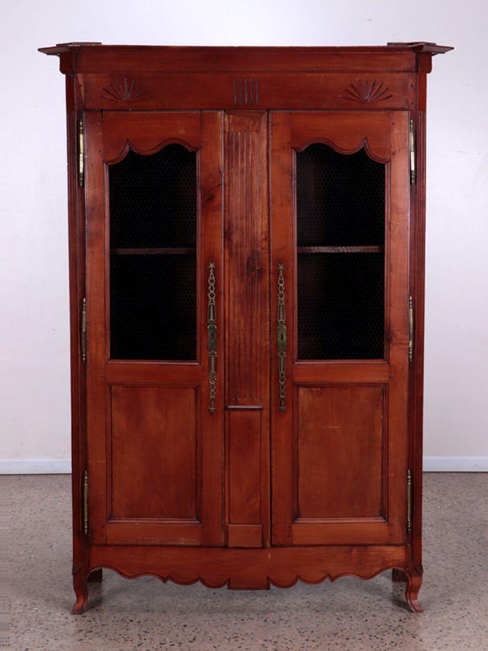 A 2 DOOR FRENCH CHERRY ARMOIRE CIRCA 1800