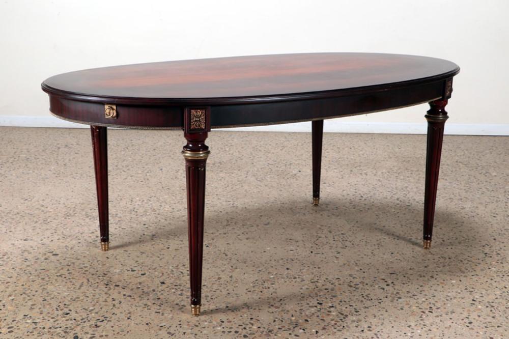 A CROTCH MAHOGANY OVAL FRENCH DINING TABLE C 1950