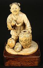 JAPANESE OKINOMO FIGURE VESSEL CIRCA 1910