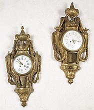 TWO FRENCH BRONZE CARTEL CLOCKS CIRCA 1880