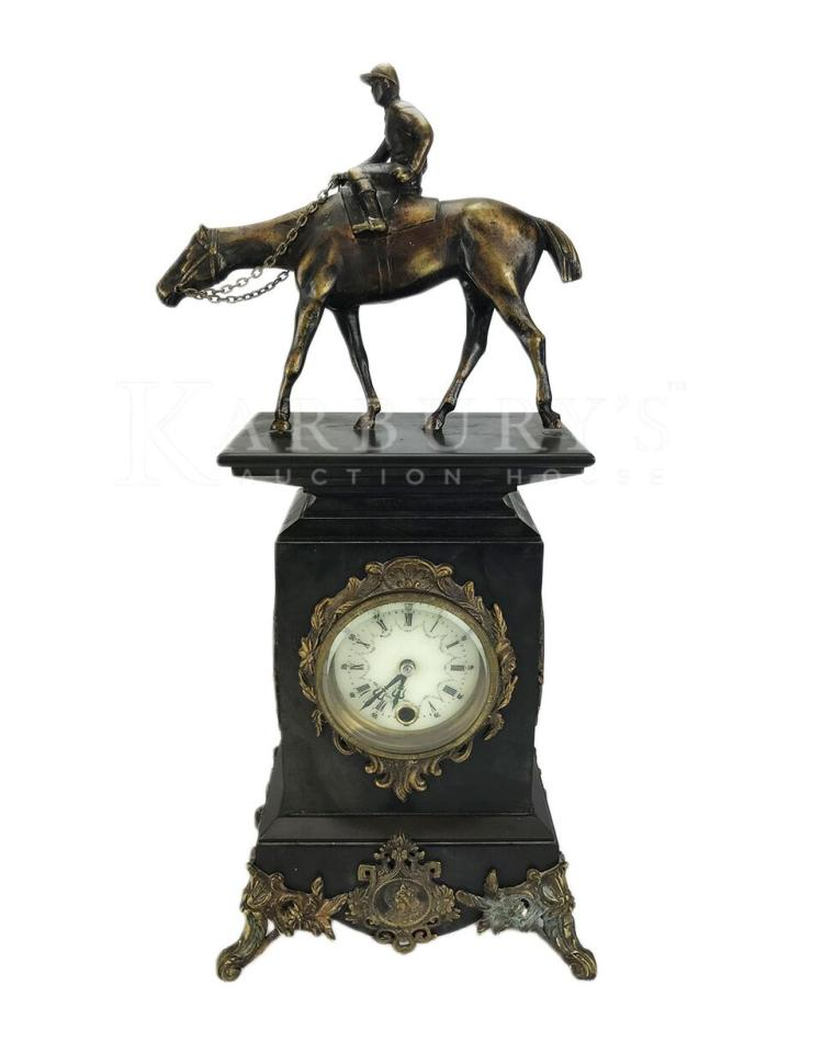 An Ornate Black Slate, Marble and Bronze Mantel Clock with Racing Horse and Jockey
