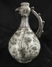 A COPPER-RED CHICKEN-FORM EWER