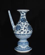 A BLUE AND WHITE WINE POT