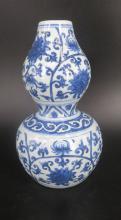 A BLUE AND WHITE GOURD VASE, ZHENGDE MARK