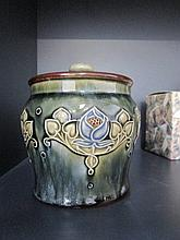 A Royal Doulton stoneware tobacco jar of typical