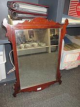 A 19th century mahogany frame mirror in the