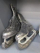 A pair of vintage ice skates, size 8, blade by