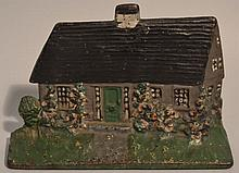 EARLY 20TH CENT. PAINTED CAST IRON COTTAGE WITH HOLLYHOCKS DOOR STOP