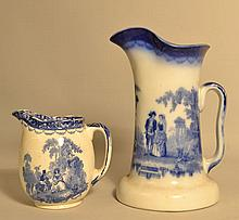 (2) 19TH CENT. DOULTON WATTEAU PATTERN BLUE AND WHITE TRANSFERWARE PITCHERS
