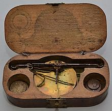 SMALL 19TH CENT. BRASS AND IRON GOLD SCALE AND WEIGHTS IN WOODEN BOX