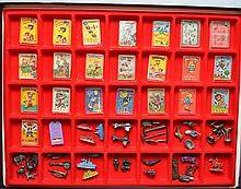 FLAT SHOWCASE COLLECTION OF (60) MISC. CRACKER JACK TOYS AND SMALL GAME PIECES