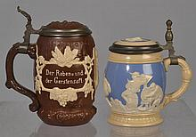 (2) VILLEROY AND BACH/METTLACH LIDDED STONEWARE STEINS