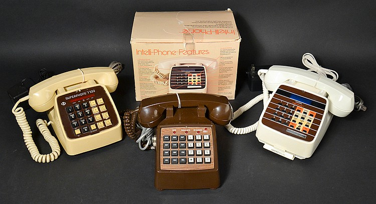 (3) DIFFERENT VINTAGE MULTI FEATURE TELEPHONES IN COLORED PLASTIC CASES