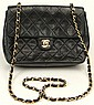 Chanel Black Quilted Leather Hand Bag. Signed Chanel, Paris. Light to Moderate Wear or else Good Condition. Measures 6-3/8 Inches by 8-1/4 Inches Long Not Counting Strap. Shipping $42.00