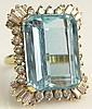 Important 25.50 Carat Natural Emerald Cut Aquamarine and Diamond Ring. The Ring is Set in the Center with a VS Clarity Aquamarine with Vivid Saturation of Color Weighing 25.50 Carats and is Bezel Set with Round Brilliant Cut and Baguette Cut Diamonds