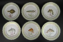 Set of Six (6) Mid 20th Century Royal Copenhagen Hand Painted Fish Plates with Green Border and Gilt Decoration. Painted by the same painters that painted the Flora Danica Fish Plates. Signed Royal Copenhagen, Royal Copenhagen Logo, #919/1710.