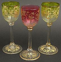 Three (3) Moser Art Glass Stems with Raised Gilt Decoration. Unsigned. Wear, Rubbing to Gilt or else Fair to Good Condition. Please Examine This Lot Carefully Before Bidding. Measures 7-1/8 Inches Tall and 2-1/4 Inches Diameter Across the Top of the