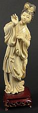 Chinese Carved Ivory Female Figure Mounted on a Hardwood Base. Nicely Detailed Carving. Very Good Condition. Figure Measures 7 Inches Tall by 2-1/2 Inches Long and 1-1/2 Inches Wide. Stand Measures 1-1/8 Inches Tall by 2-3/8 Inches Long and 1-5/8