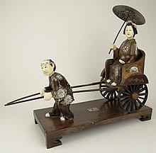 Japanese Carved Ivory and Carved Hardwood Figural Rickshaw on Carved Wood Base. Signed. Small Repair to Left Facing Pole at Hand. Measures 11-1/4 Inches Tall and 13 Inches Wide. This item will only be shipped domestically and was legally imported