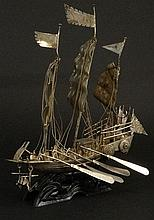 Antique Chinese Silver Model of a Junk-style Masted Sailing Ship; with Three Full Sails, Figures and Canons. Signed with Calligraphy Marks. Wear and Minor Losses. Measures 7-1/4 Inches Including Man Made Stand. Weighs 4.80 Troy ounces Including Base.