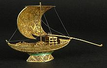 Vintage Chinese Gold Washed Filigree Silver Model of a Junk-style Masted Sailing Ship. Enameled Accents at Base. Unsigned. Very Good Condition. Measures 3 Inches Tall, 5-1/2 Inches Length. Shipping $42.00