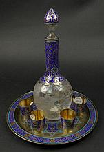 Early 20th Century Russian Grachev Bros. Silver, Champlevé Enamel and Etched & Cut Chrystal Eight (8) Piece Cordial Set Comprising Round Tray, Decanter and Six (6) Cups. Each Piece Signed with Cyrillic Mark of Grachev Bros. and AP Workmaster's Mark,