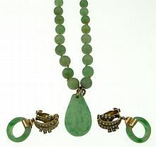 Vintage Chinese Jade Necklace and Earring Group. This Suite includes a Necklace Comprised of Green Jade Beads ranging in Size from 4.7mm to 9mm with a Jade Drop Pendant with a Gold and Diamond Clasp, Measures 21-3/4 Inches Length; Pair of Jade Rings,