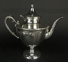 Early 20th Century Sterling Silver Pedestal Tea Pot. Signed Sterling. Good Condition. Measures 9-3/4 Inches Tall and 10-1/2 Inches Wide. Approx. Weight: 25.48 Troy Ounces. Shipping $42.00