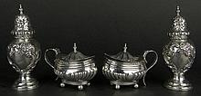 Two (2) Pair English Sterling Silver Table wares. The Lot includes Two (2) Lidded Salts, One With Cobalt Glass Liner, Signed with Hallmarks: Birmingham, 1898, Makers Mark. Light Dings, Measures 2-3/4 Inches Tall; Two (2) Salt Shakers, Signed With