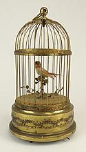 Antique French Automaton Singing Bird in Cage Signed Made In France. Working Order. Signs of Age or in otherwise Good Condition. Measures 11 Inches Tall, 6-1/2 Inches Diameter. Shipping $62.00