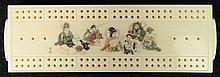 Japanese Carved Ivory Cribbage Board with Polychrome Seven Immortals and with Pegs in Side Compartments. Signed. Good Condition or Better. Measures 6-3/8 Inches Long and 2 Inches Wide. This item will only be shipped domestically and was legally