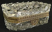 Early 20th Century French Crystal Vanity Box with Bronze Mounts. Unsigned. Chips or else Good to Very Good Condition. No Key. Measures 2-3/4 Inches Tall, 6-3/8 Inches Long and 3-3/4 Inches Depth. Shipping $45.00