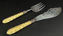 Very Fine English Silver and Ivory Fish Server Set. Both Fork and Knife with Ornate Chased and Pierced Motif. The Ivory Handles, Studded. Both Signed With Hallmarks: Sheffield, 1878, Maker Harrison Bros. and Howsen (HH) Handles Typically Yellowed