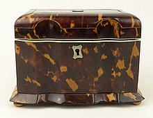19th C English Tortoise Shell Tea Caddy. The interior with two lidded zinc foil-lined compartments for tea, each lid of tortoise with Ivory pull. The interior lid and base lined in Ivory. The lid with original felt backing. Ivory Ball Feet. Original