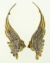 Retro 1980's Winged 18 Karat Yellow Gold and Diamond Clip-On Earrings. Unsigned. Good Condition. Each Measures 2-3/4 Inches Length. The Pair Weighs approx. 18.15 Pennyweights. Shipping $28.00