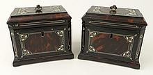 Pair 19th C English Ebony and Tortoise Shell Tea Caddies With Ivory Inlay. The interiors with foil lined compartment for tea, each lid of tortoise with Ivory pull. Original Key. Each With Silver Tea Name Plate: Green and Bohea. Unsigned. Minor Losses