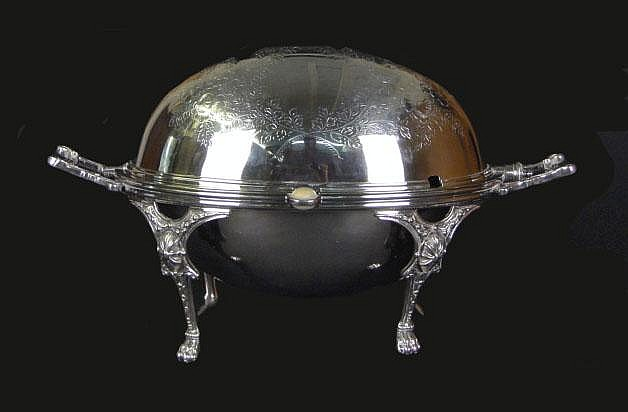Victorian Silver Plate Toast Warmer Server. Decorated Lid With Fancy Feet and Handles. Two (2) Inserts, One Pierced. Signed on Bottom G D & Co. Ltd. 953. One of the housings for the Roll Top is Missing from One Side, Minor Abrasions on Interior Plate